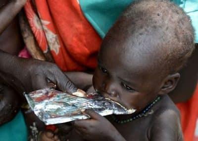 Children, eating a high-energy peanut paste